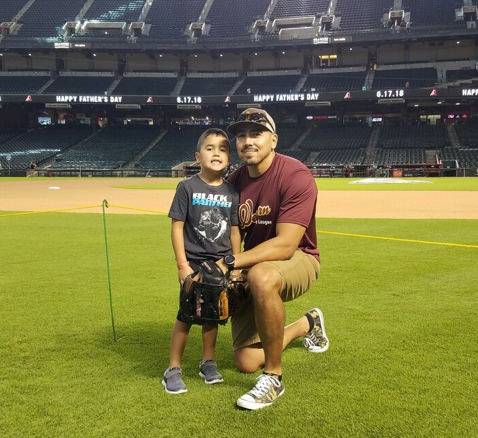 Father and Son At Baseball Game